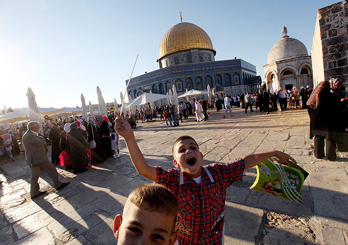 Palestinian children celebrate around the Dome of the Rock at al-Aqsa