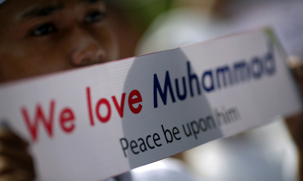 Muslim protester holds up a banner outside the U.S. embassy in Bangkok